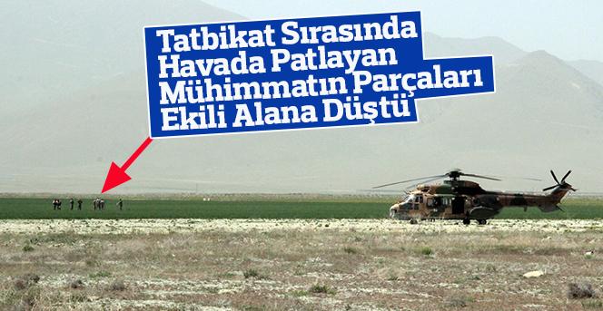 Havada patlayan mühimmat ekili araziye düştü