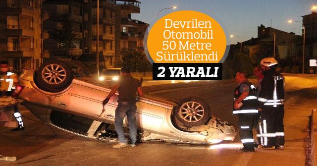 Devrilen otomobil 50 metre sürüklendi: 2 yaralı